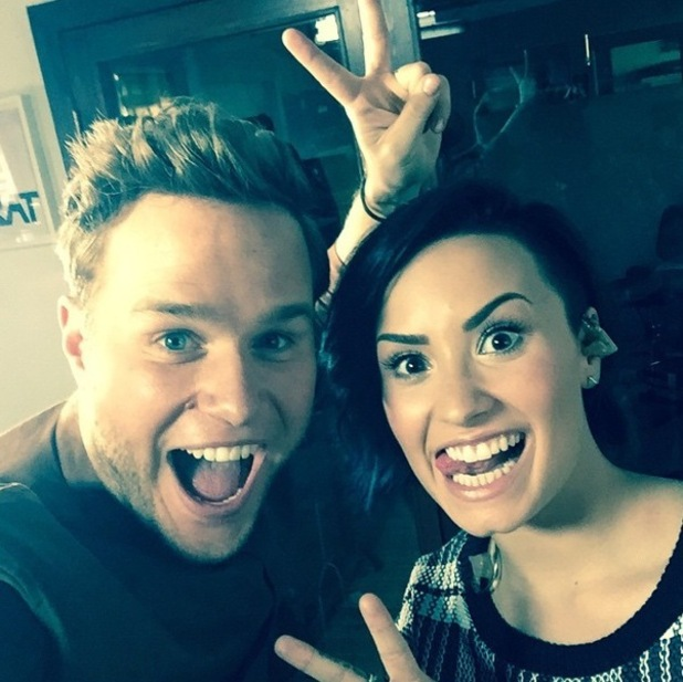 Olly Murs and Demi Lovato perform together 12 November