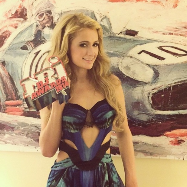 Paris Hilton poses with her NRJ DJ Award in Monaco, France - 12 November 2014