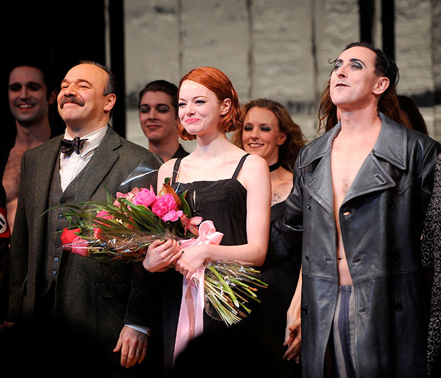 Danny Burstein, Emma Stone and Alan Cumming onstage during Emma Stone's debut performance in Broadway's 'Cabaret' at Roundabout Theatre Company's Studio 54 on November 11, 2014 in New York City.