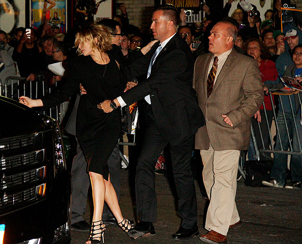 Jennifer Lawrence signs autographs for fans outside the Ed Sullivan Theatre when barrier gives way, 12 November 2014
