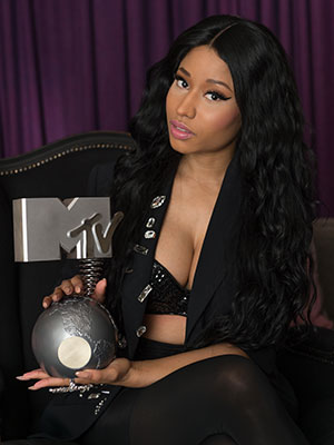Nicki Minaj, host of the MTV EMA's 2014 poses at the Blythswood Square Hotel on November 8, 2014 in Glasgow, Scotland. (Photo by Ian Gavan/MTV 2014/Getty Images for MTV)