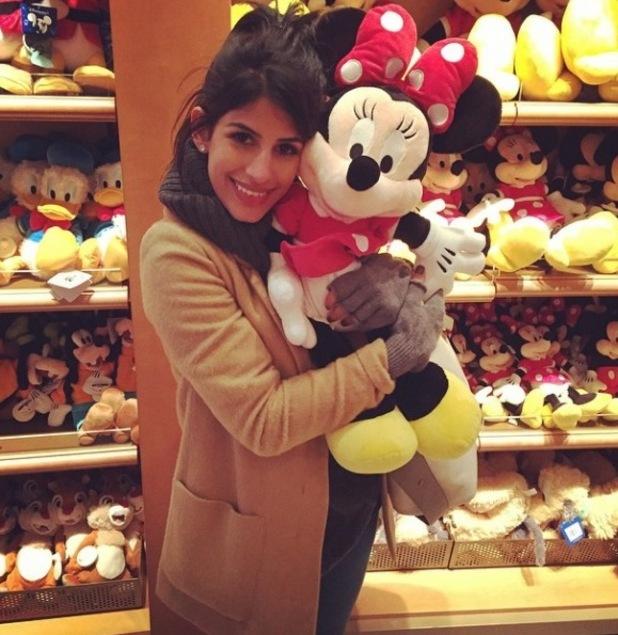 TOWIE's Jasmin Walia cuddles up to a Minnie toy at Disneyland Paris - 17 November.