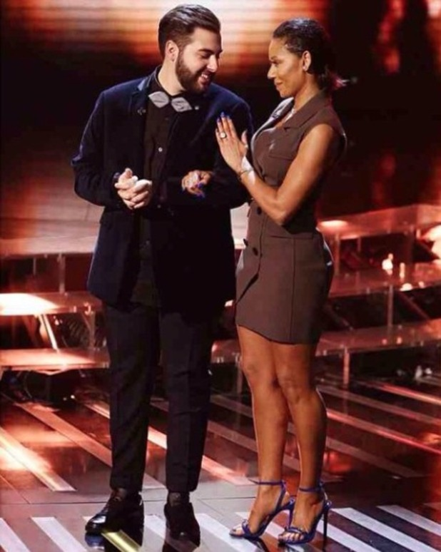 Mel B poses with last surviving contestant, Andrea Faustini in X Factor live show, 22 November 2014