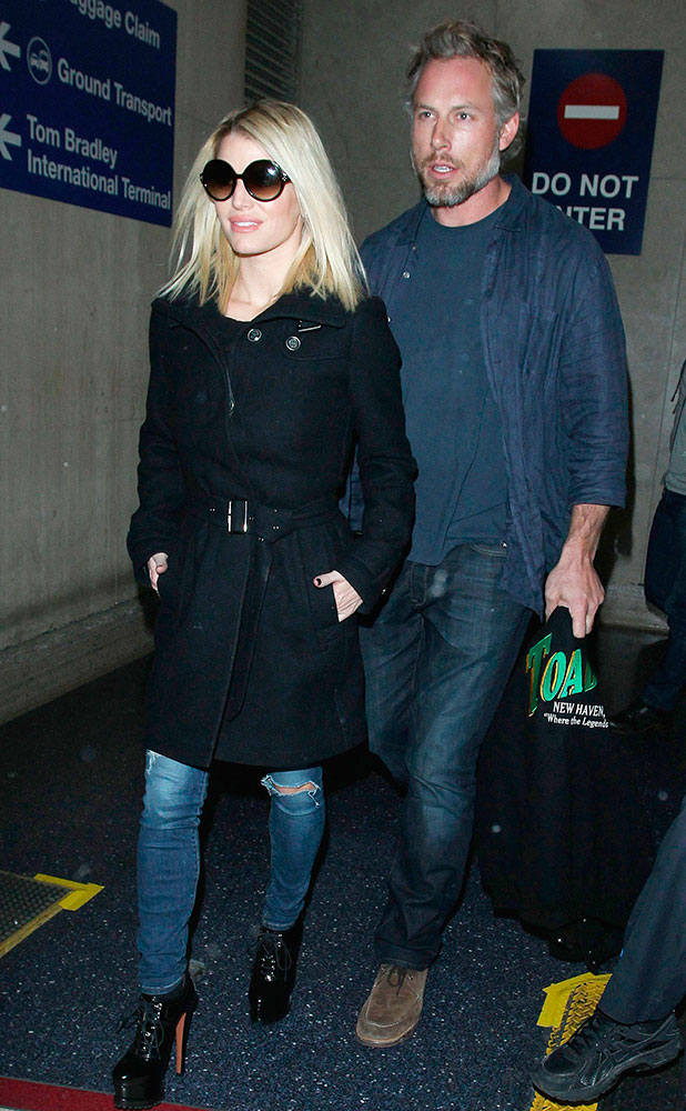 Jessica Simpson and husband Eric Johnson arriving at the Los Angeles International Airport, America - 16 Nov 2014