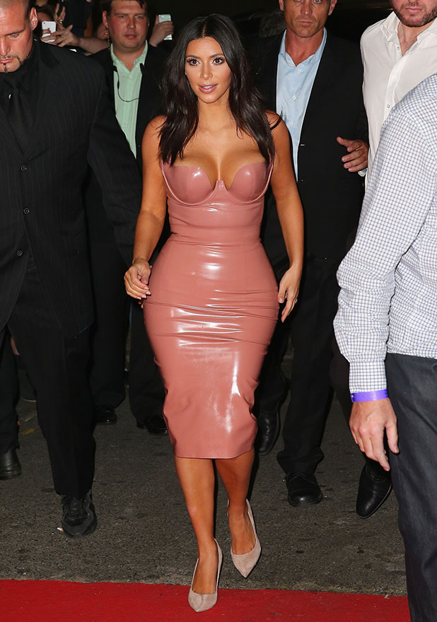 Kim Kardashian arrives surrounded by security men to promote her new fragrance 'Fleur Fatale' at a Spice Market event on November 18, 2014 in Melbourne, Australia.