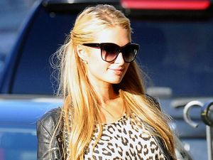 Paris Hilton teams leopard print top with lace-up heels while out in NY
