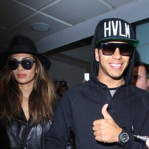 Lewis Hamilton, the 2015 Formula One champion, and Nicole Scherzinger arrive at London Heathrow Airport - 24/11/2014.