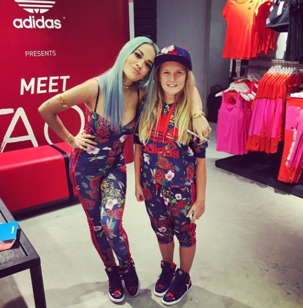 Rita Ora revisits blue hair and poses with a 'mini me' fan at Adidas store opening in Abu Dhabi, 22 November 2014