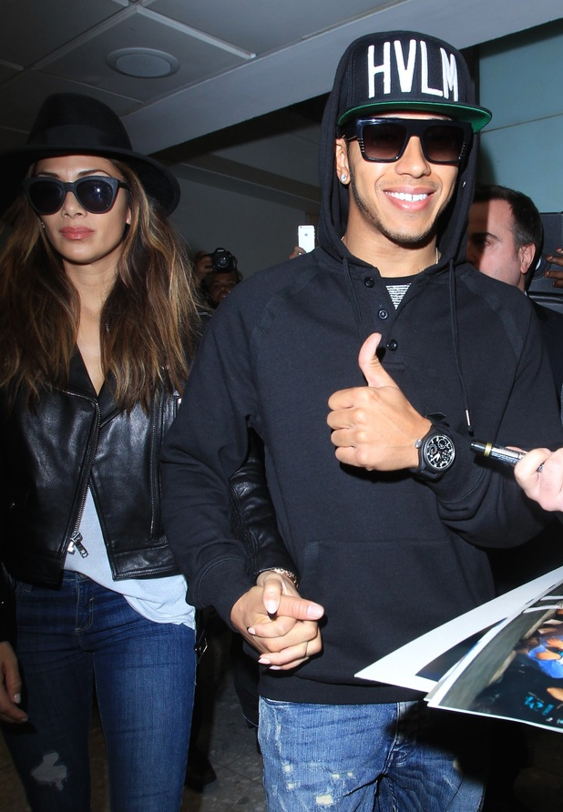 Lewis Hamilton, the 2015 Formula One champion, and Nicole Scherzinger arrive at London Heathrow Airport - 24/11/2014.