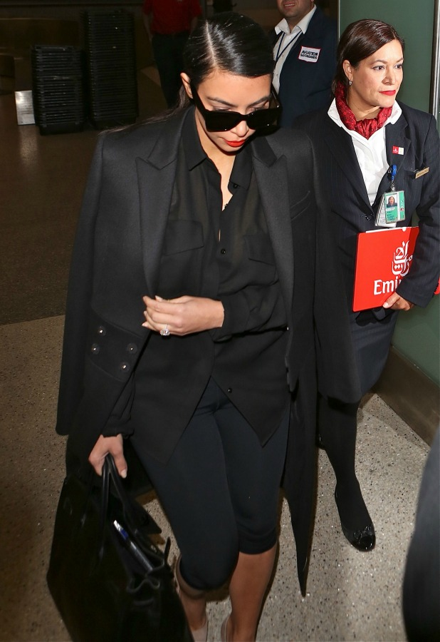 Kim Kardashian West arrives at Los Angeles International Airport, 25 November 2014