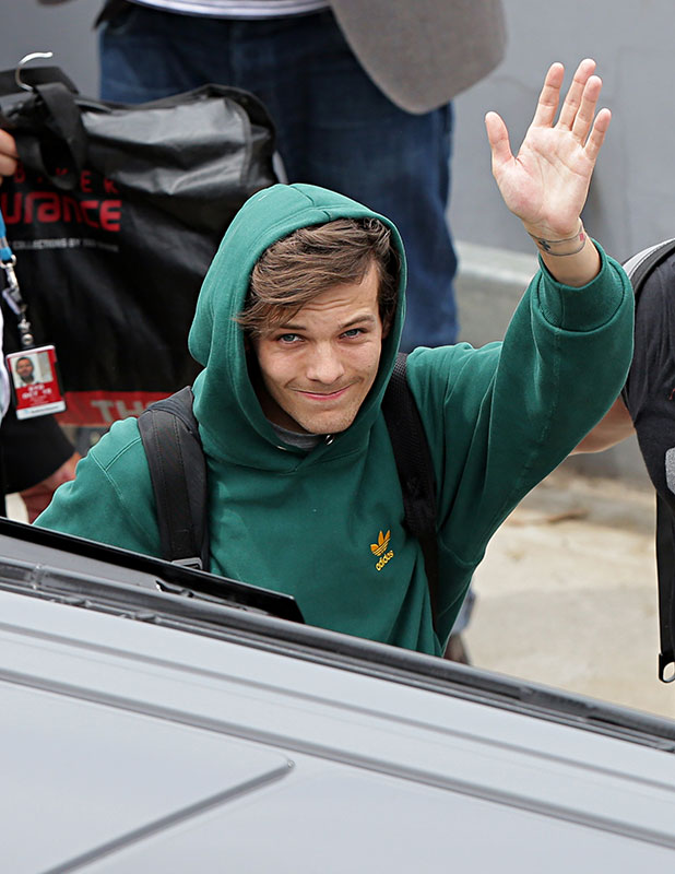 Louis Tomlinson of One Direction arrives into Sydney on November 25, 2014 in Sydney, Australia.