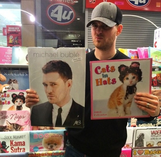 Michael Buble poses with his calendar at Calendar Club - 4 Dec 2014