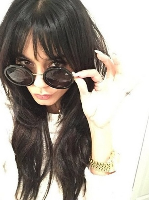 Vanessa Hudgens shows off her new jet black hair extensions - 4 December 2014