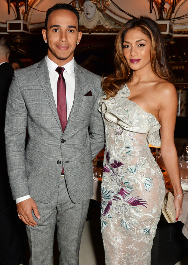 Nicole Scherzinger and Lewis Hamilton attend the British Fashion Awards at London Coliseum on December 1, 2014 in London, England.