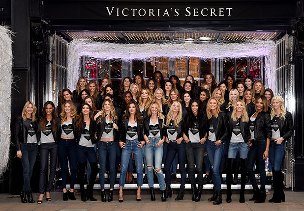 (Front row 2nL-R) Victoria's Secret models Joan Smalls, Doutzen Kroes, Lily Aldridge, Behati Prinsloo, Alessandra Ambrosio, Candice Swanepoel, Elsa Hosk, Adriana Lima, Karlie Kloss, Lily Donaldson, Jourdan Dunn and Devon Windsor attend the 2014 Victoria's Secret Fashion Show - Bond Street Media Event on December 1, 2014 in London, United Kingdom.