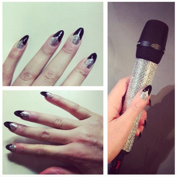 Sarah-Jane Crawford shows off her black and glitter manicure, X Factor Live show, 13 December 2014