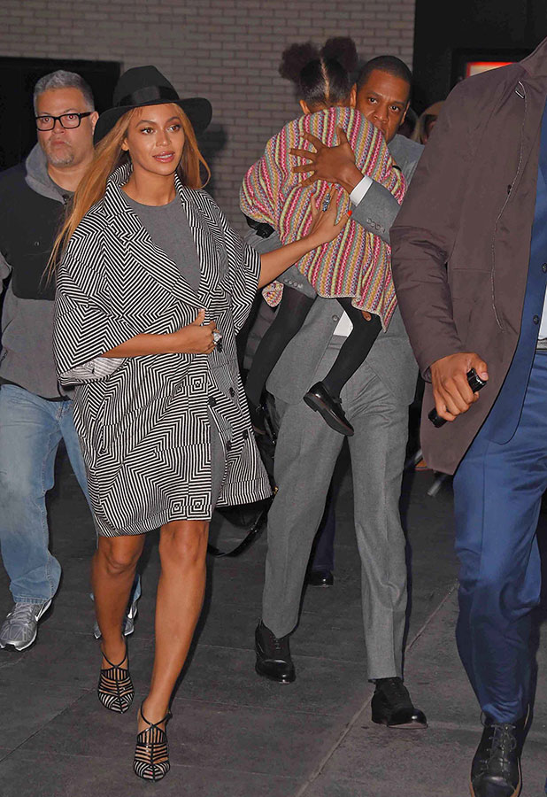 Beyonce Knowles, Jay-Z and Blue Ivy are seen on December 7, 2014 in New York City.