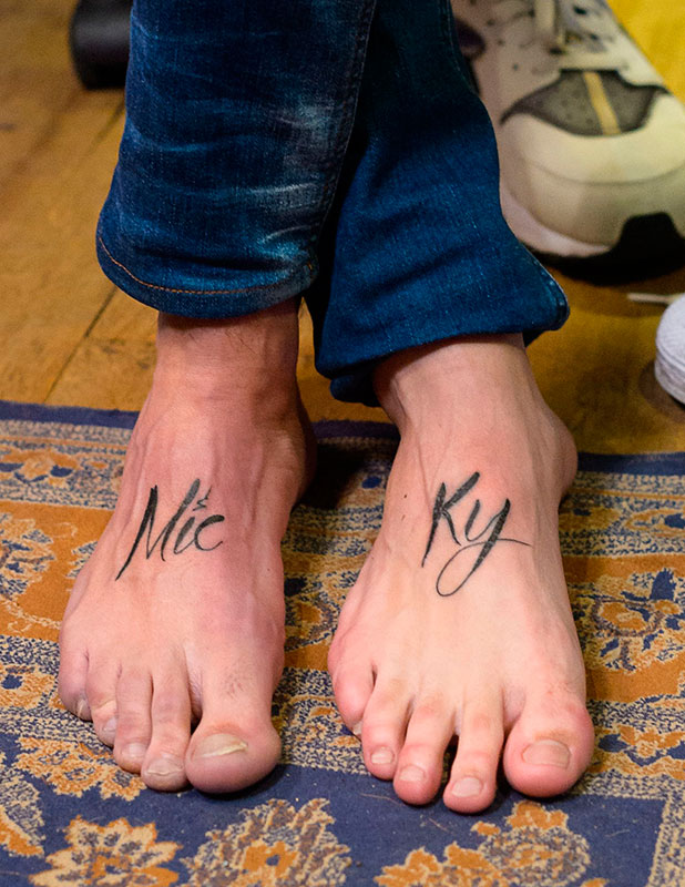 Ricky Rayment and Mario Falcone showing off their new foot tattoos that combine to spell 'Micky' 'Micky' being a combination of Mario and Ricky 25 Nov 2014