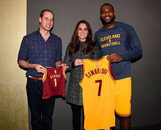 Prince William, Duke of Cambridge and Catherine, Duchess of Cambridge pose with basketball player LeBron James (R) backstage as they attend the Cleveland Cavaliers vs. Brooklyn Nets game at Barclays Center on December 8, 2014 in the Brooklyn borough of New York City.