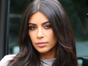 Kim Kardashian is gorgeous in grey after criticising mum Kris' outfits