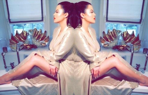 Khloe Kardashian rocks glowy cheek highlighter while posing for an Instagram picture - 18 December 2014
