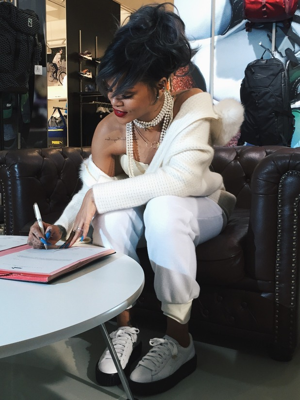 Rihanna signs the contract to become the new creative director of Puma - 17 December 2014