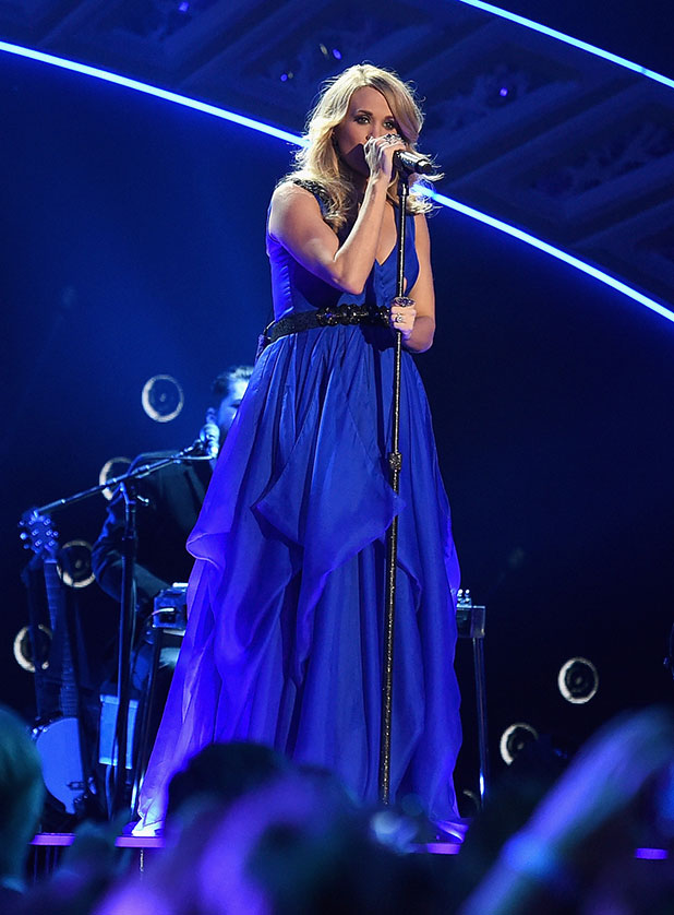 Carrie Underwood performs at the 2014 American Country Countdown Awards at Music City Center on December 15, 2014 in Nashville, Tennessee.