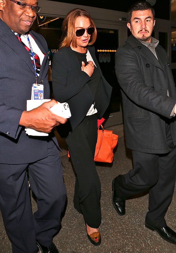 Lindsay Lohan arrives on a flight to Los Angeles International Airport (LAX), 16 December 2014