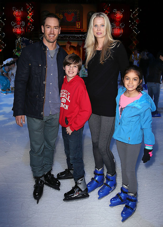 Mark-Paul Gosselaar (L), wife Catriona McGinn and his children Michael Charles Gosselaar and Ava Lorenn Gosselaar attend Disney On Ice presents Let's Celebrate! at Staples Center on December 11, 2014 in Los Angeles, California.