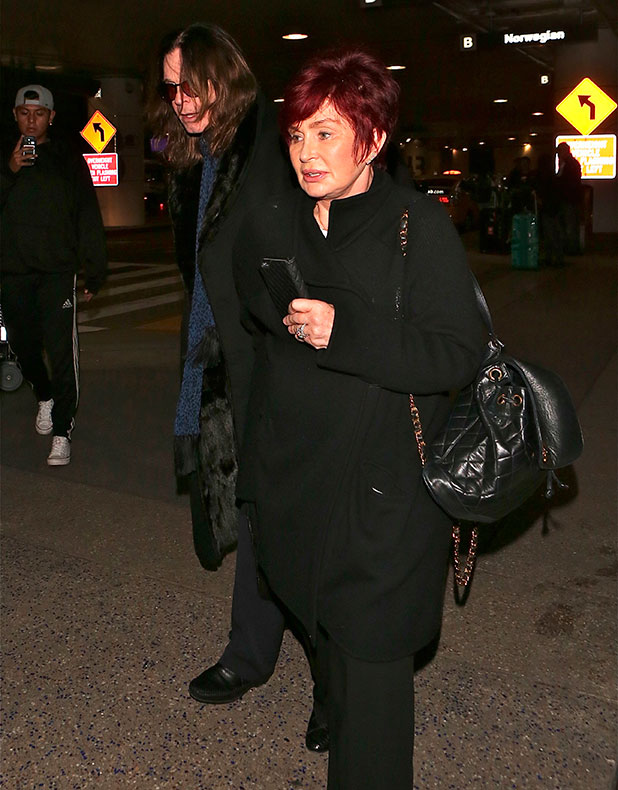 Ozzy and Sharon Osbourne arrive at Los Angeles International (LAX) airport, 16 December 2014