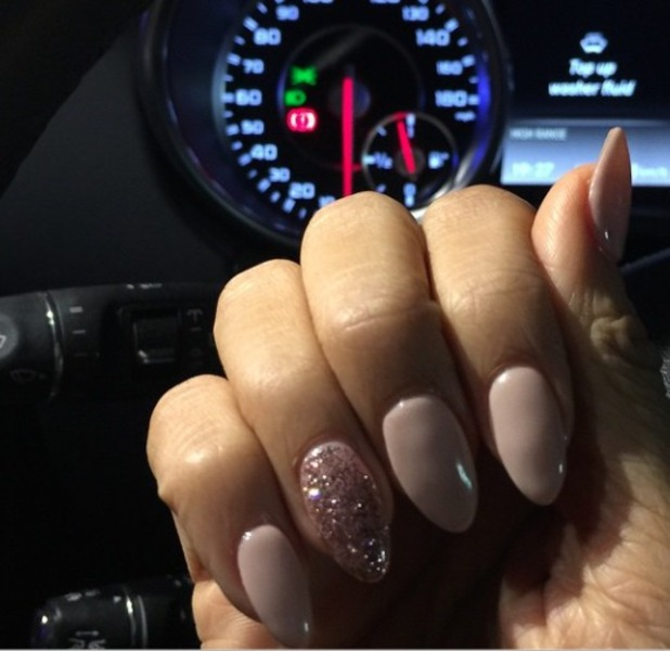 Rochelle Humes shows off the nude and rose gold glitter ring finger manicure she had done at Blobar, Buckhurst Hill, 23 December 2014