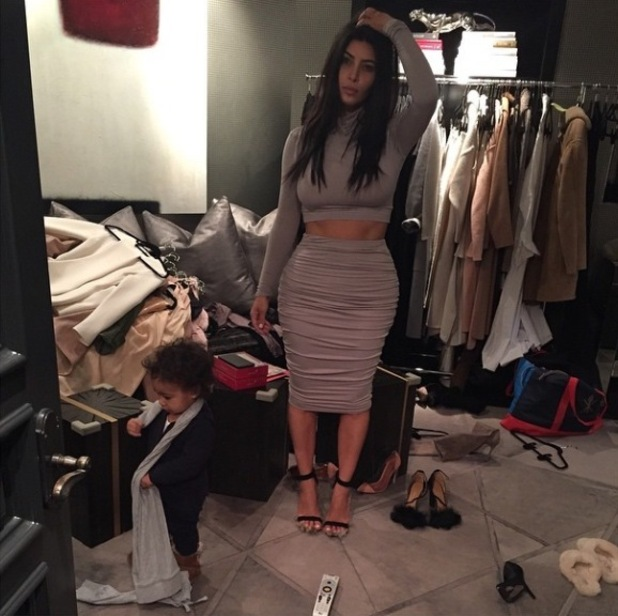 Kim Kardashian poses in her closet with baby daughter North - 22 Dec 2014