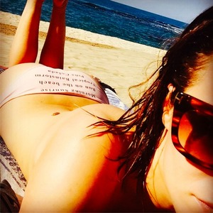 Caroline Flack shares pictures from her New Year holiday to Jamaica, 31 December 2014
