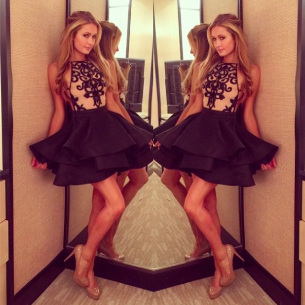 Paris Hilton shows off her Michael Costello dress for New Year's Eve, 1 January 2015