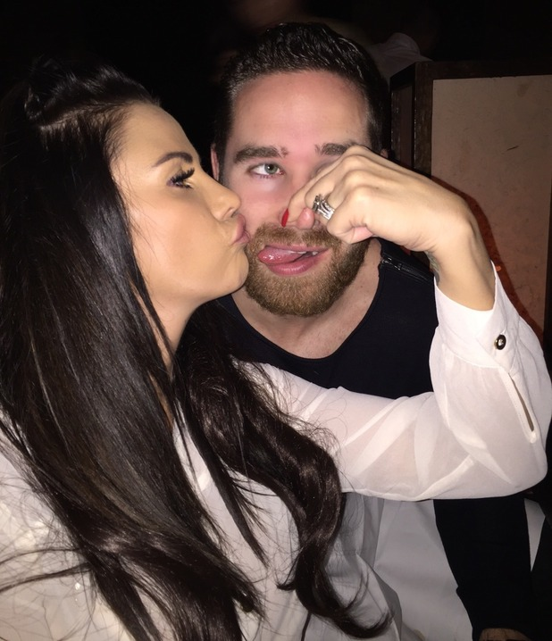 Katie Price shares a kiss with husband Kieran Hayler on New Year's Eve 2014.