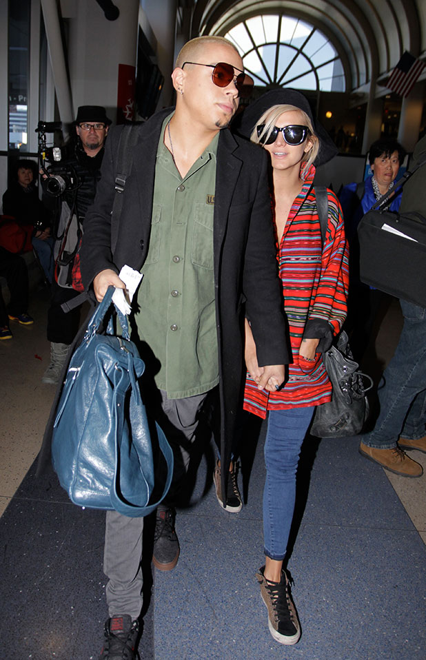 Ashlee Simpson and Evan Ross at Los Angeles International Airport (LAX), 31 December 2014