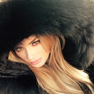 Chloe Sims poses in her new black faux-fur coat, a gift from by Elliot Wright, 29 December 2014
