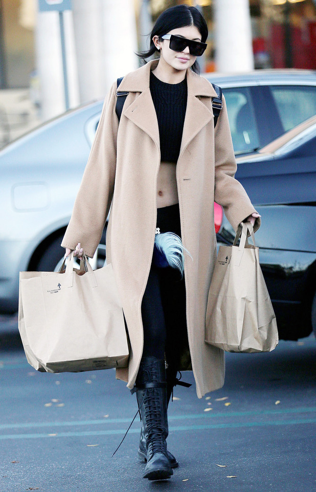 Kylie Jenner wears a camel coat while out grocery shopping in Los Angeles, America - 28 December 2014