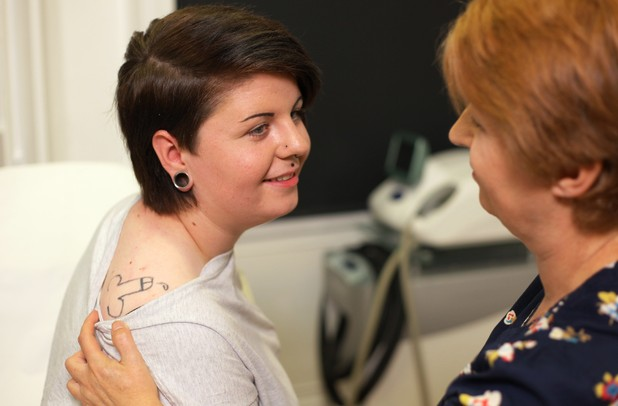Holly showing her mum the tattoo