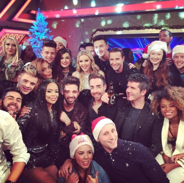 Sarah-Jane Crawford poses with the X Factor team after the Christmas grand final, 15 December 2014