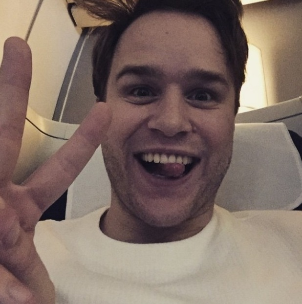 Olly Murs on a plane to New York City - 13/01/15.