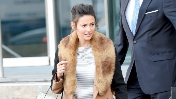 Michelle Keegan leaves the Lowry Hotel in Manchester with a Happy Birthday bag. She was staying with boyfriend Mark Wright. The concierge helped her down the steps with her bag. 24 Jan 2015