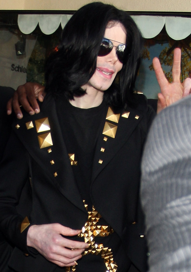 Michael Jackson is flanked by security as he leaves Tom's Toys after going on a shopping spree with his children Los Angeles, California -15.05.09