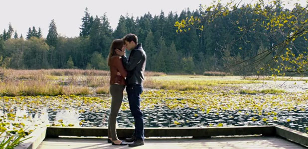 Fifty Shades of Grey: still from Ellie Goulding's Love Me Like You Do music video, January 2015 Christian and Ana kiss by lake