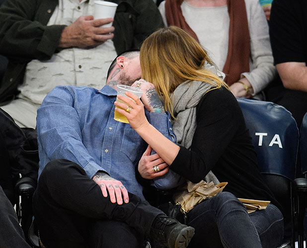 Benji Madden (L) and Cameron Diaz kiss at a basketball game between the Washington Wizards and the Los Angeles Lakers at Staples Center on January 27, 2015 in Los Angeles, California.