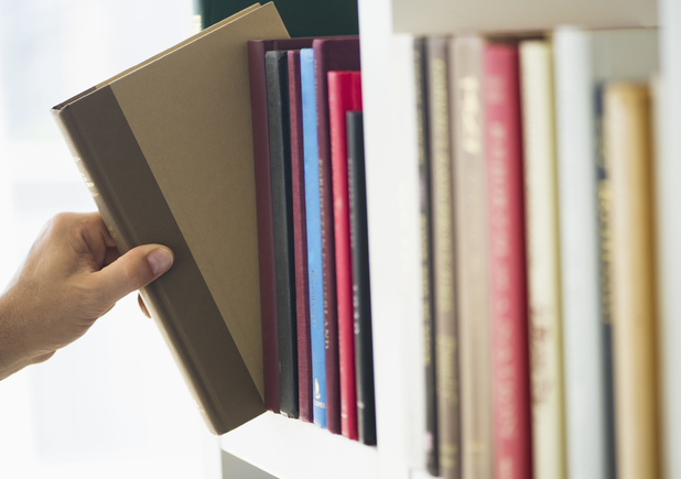 Hand picking up book