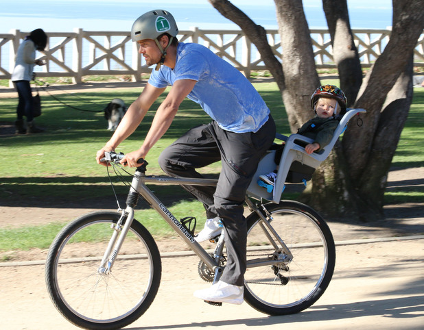 Josh Duhamel takes his son Axl on a cycle ride around LA's Brentwood area on a sunny sunday afternoon. 01/04/2015. Los Angeles.