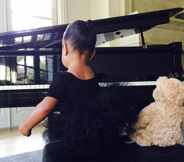 Kim Kardashian shares photos of daughter North West dressed as a ballerina while playing the piano - 4 February 2015.