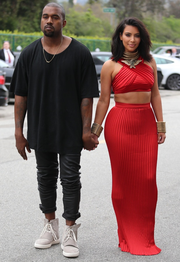 Kim Kardashian and Kanye West arrive at the Roc-Nation Pre-Grammy party, 7 February 2015