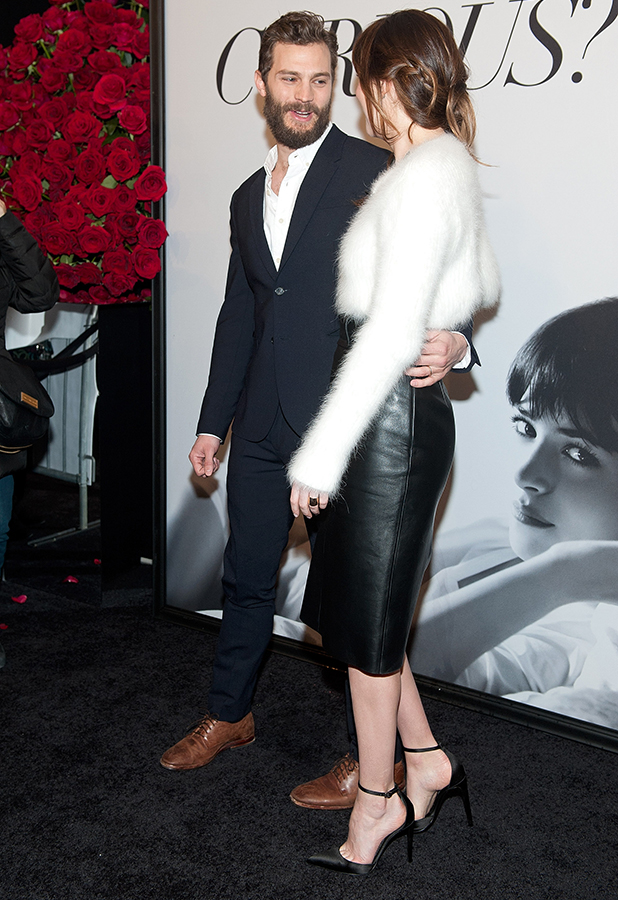 Jamie Dornan (L) and Dakota Johnson attend the 'Fifty Shades of Grey' Fan First Screening at Ziegfeld Theatre on February 6, 2015 in New York City.